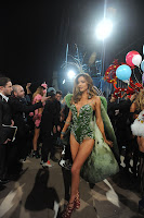 Miranda Kerr wearing a hot green outfit