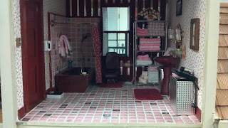 miniature bathroom with pink theme in a doll house