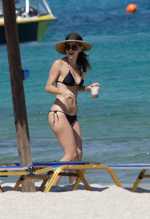 Maria Menounos shows off her body in a string bikini