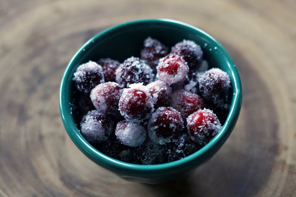 Bowl of homemade candied cranberries that look like ice-frosted berries.