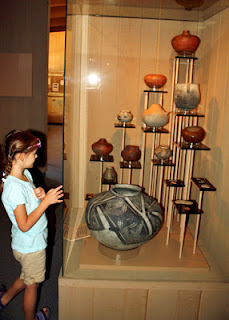 While learning about Ancestral Puebloan pottery at Navajo National Monument, Tessa was to find the smallest and largest pots from various displays within the exhibit hall and then record their individual uses.