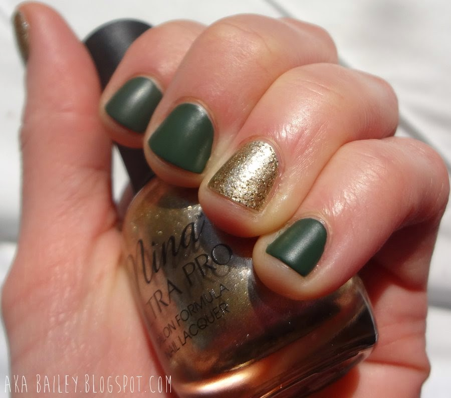 St. Patrick's Day nails: Gold glitter accent nails with matte emerald green nails