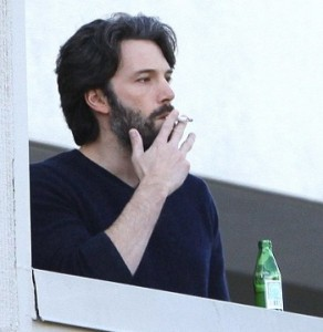 Ben Affleck smoking a cigarette (or weed)