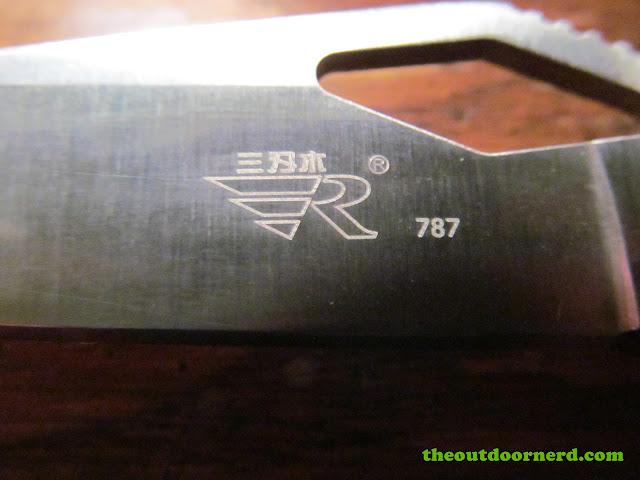 Sanrenmu B787 Pocket Knife - closeup of laser etched logo