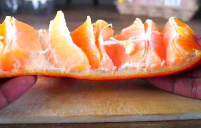 Cara Mengupas kulit Jeruk yang Benar dan Praktis