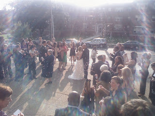 wedding kiss in bright light with bubbles