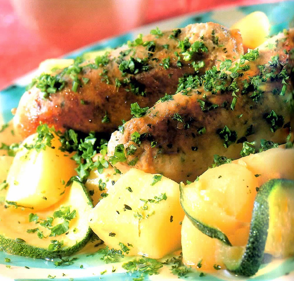 Potato and Sausage Pan-fry: A supper dish of sausages and potatoes cooked together in a pan that's finished with a wine-based sauce and fresh herbs