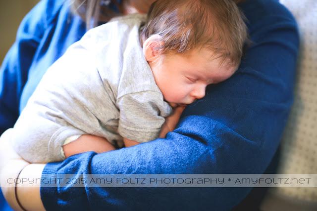 photo of newborn cuddling with mommy