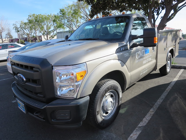 Commercial vehicles economically repainted to match corporate fleet colors