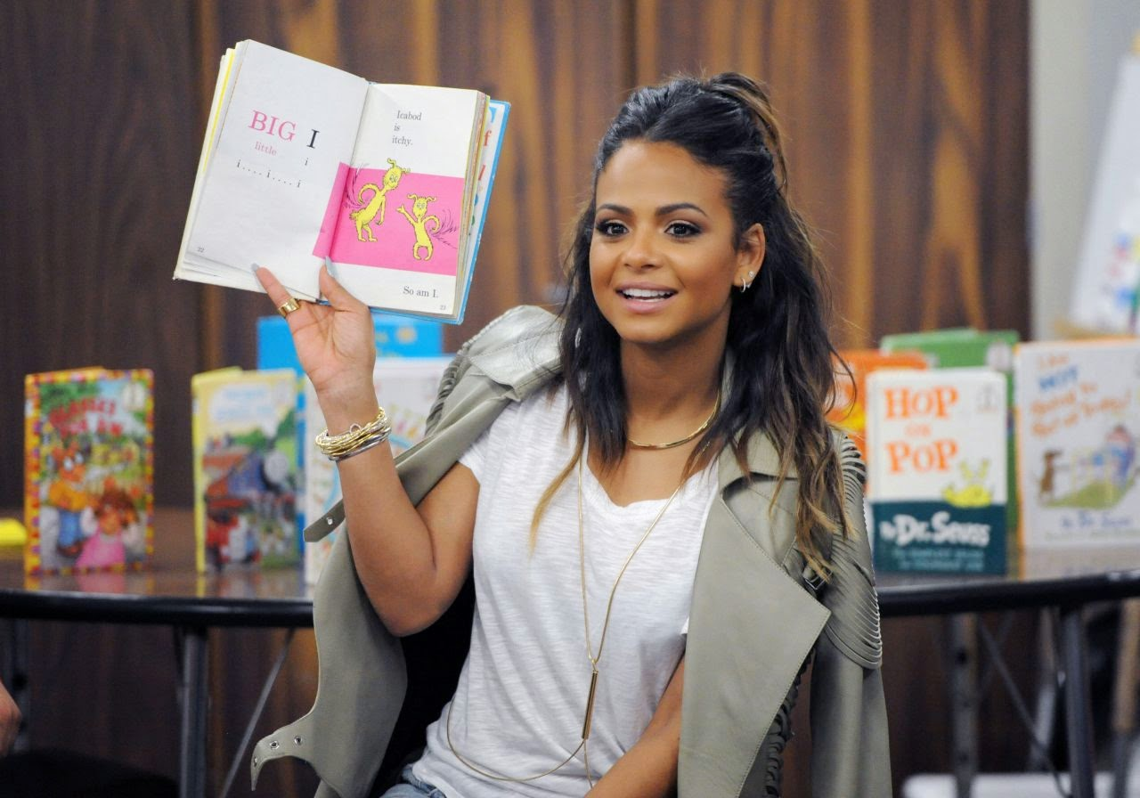 Actress, singer-songwriter @ Christina Milian in Ripped Jeans for 'Read Across America' Program in LA