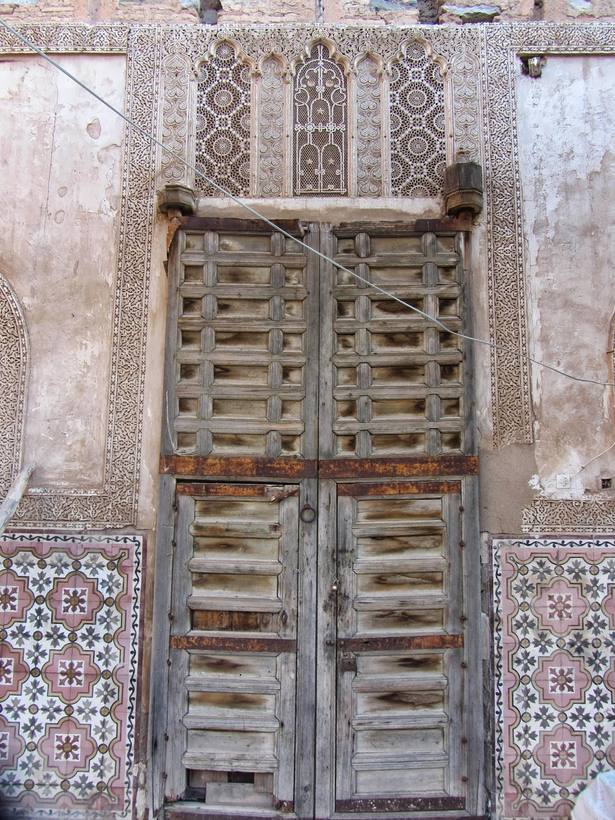 Plaster detailing around a antique Moroccan door - Buying Antique Moroccan Doors At The Marrakech Flea Market - Bab El