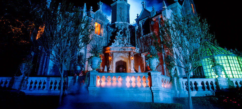 the haunted mansion is a spooky tour of an ominous haunted house in ...