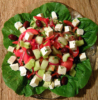 Yummy Looking Salad on Platter with Romaine Leaves