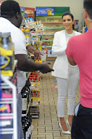 Kim Kardashian payin for gas at 7 11 in Miami