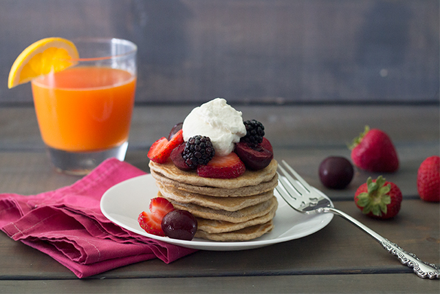 Recipe for the best whole grain pancakes (topped with fresh fruit and whipped cream).