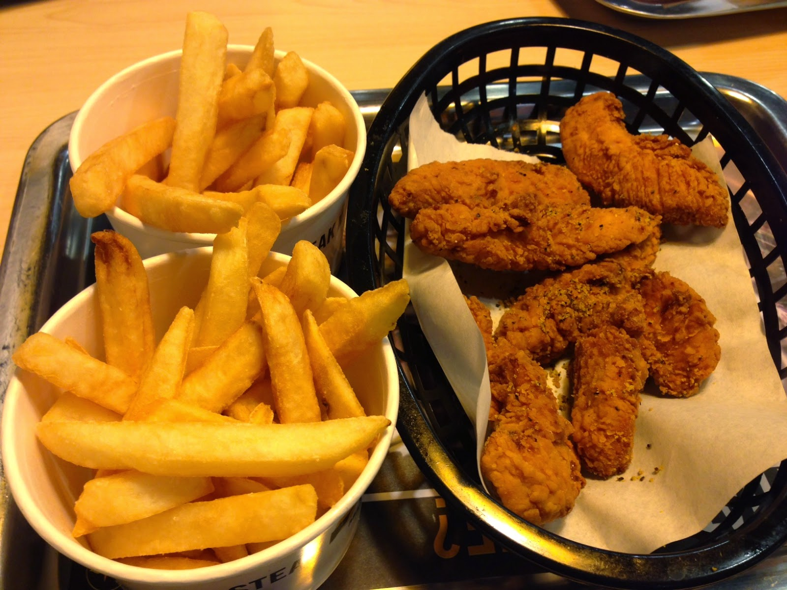 Lemon chicken tenders and fries.