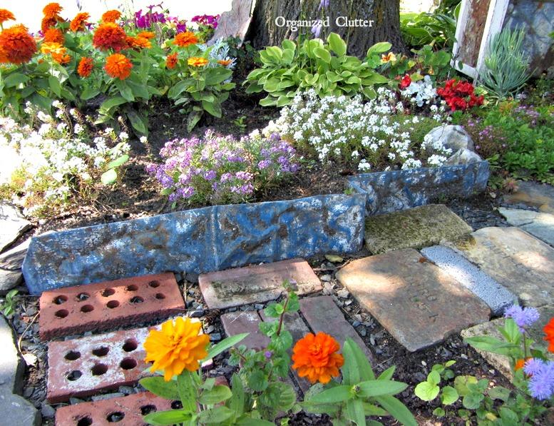 Hammered Tin Garden Edging www.organizedclutterqueen.blogspot.com