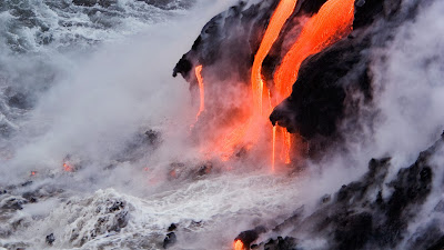 Viscous lava from Kilauea pours into the ocean at Kalapana, Hawaii (© Ron Dahlquist/Aurora Photos) 453
