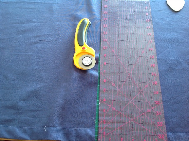Curtain with rotary cutter and mat. The waste has been cut off.