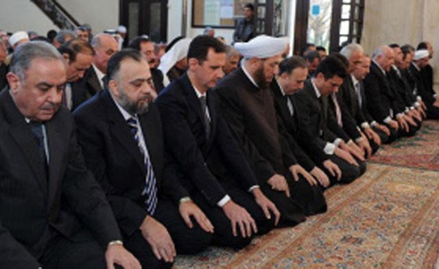 Resimde BEşar Esad'ın solundaki kişi Suriye genel müftüsü ve sünni Ahmet Bedrettin Hassun