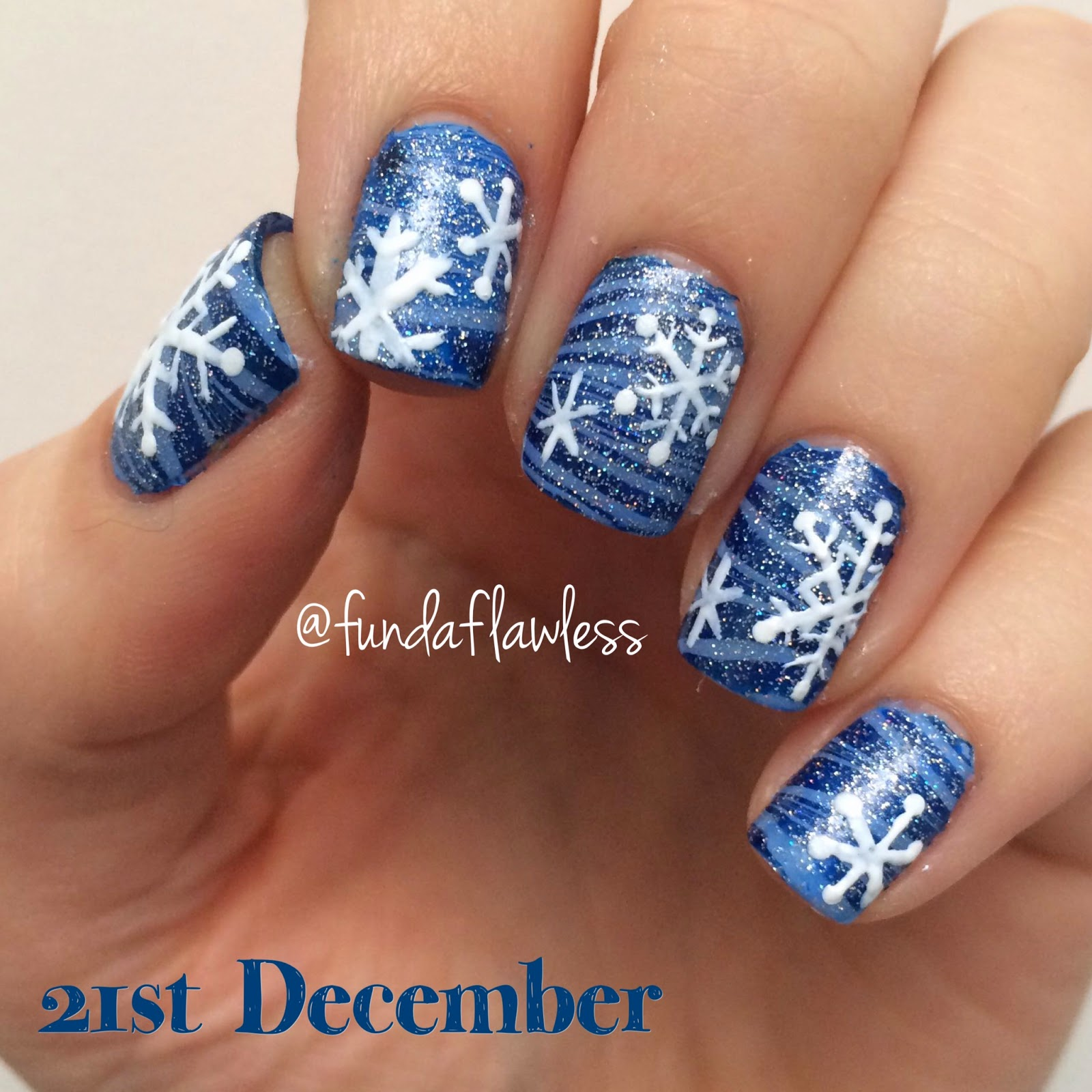 Blue watermarble with snowflakes nail art