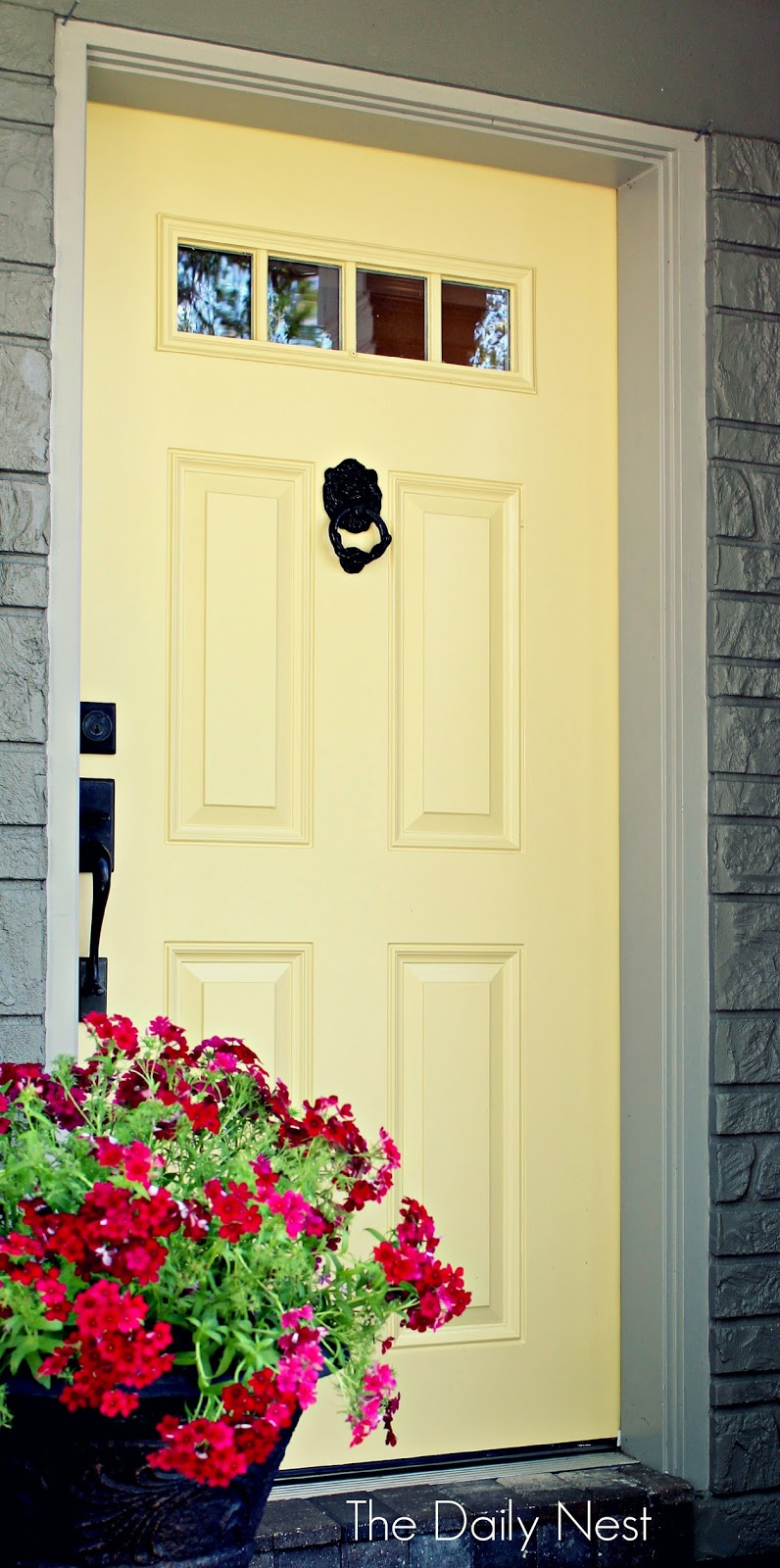 Spring ifying my front porch with a yellow door for Front door yellow paint