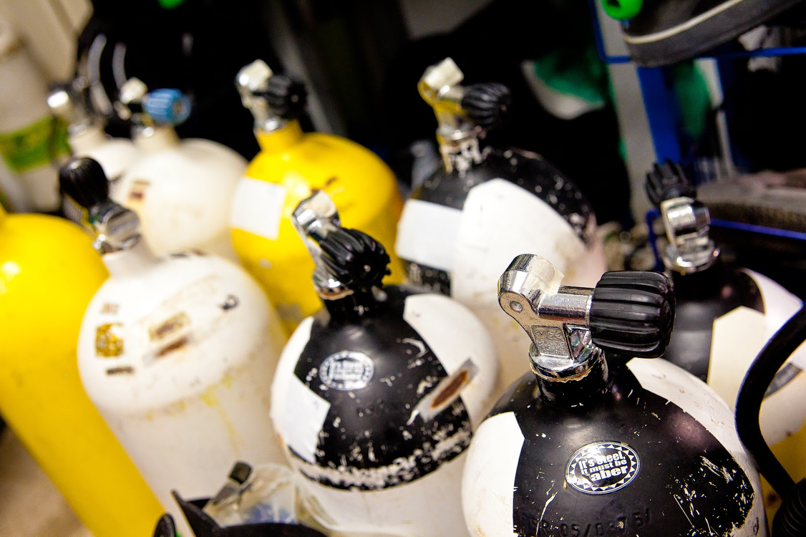 8 scuba diver cylinders with valve at the dive centre