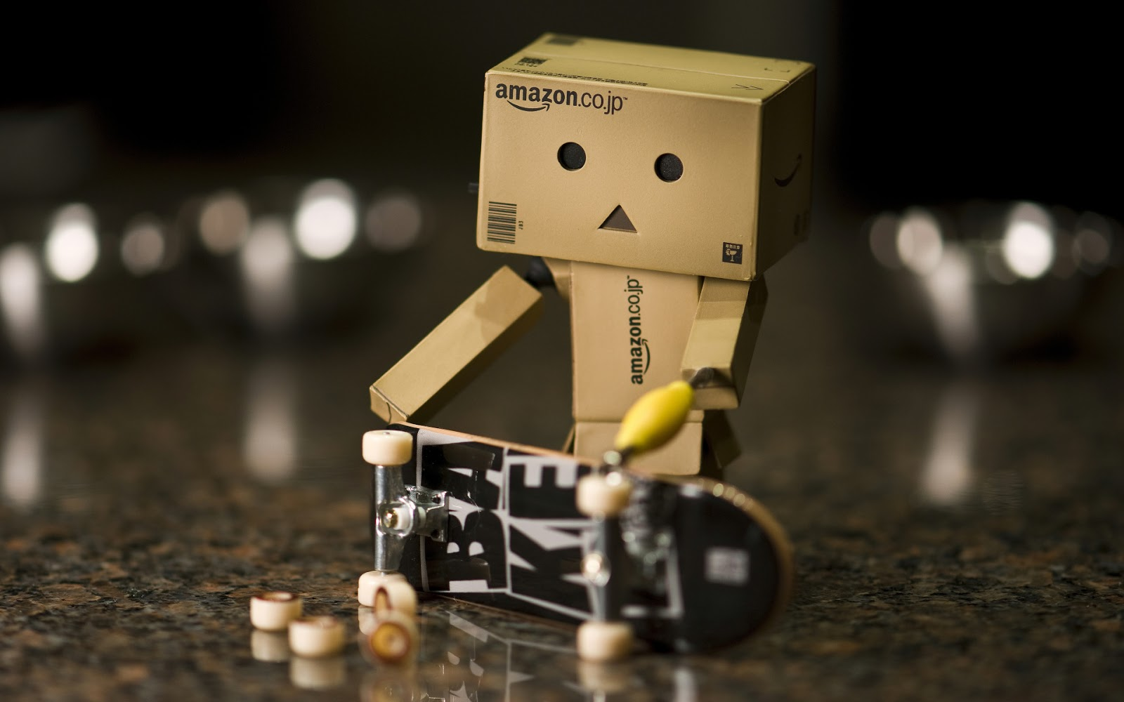 Danbo Jr. assembling a skateboard