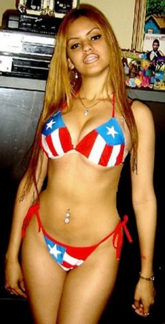 Aspiring waitress Melody Morales proudly displaying Puerto Rican flag