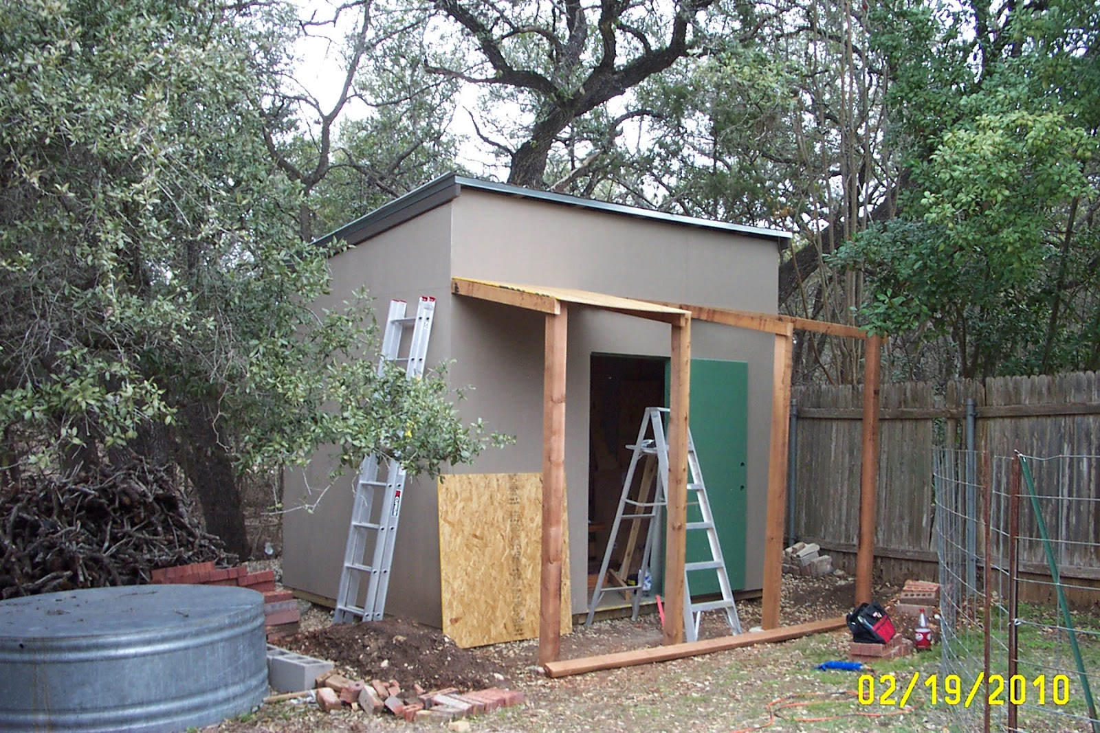 Rock oak deer texas style shed project for Rustic shed with porch