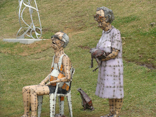 old man and woman sculpture by the sea