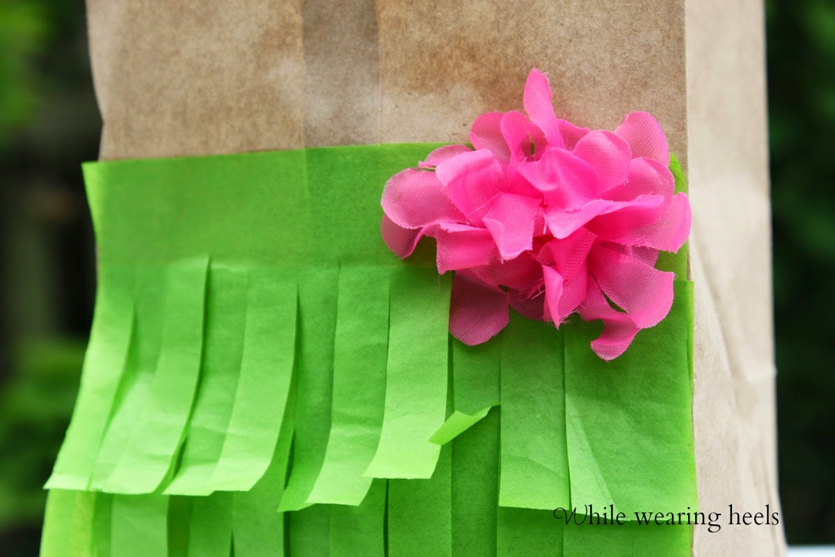 While wearing heels garden party favor bags i used 3 layers of tissue paper and some double sided tape for the fringed grass and a hawaiian lei was sacrificed so i could hot glue a flower to the izmirmasajfo