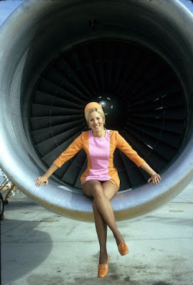pretty blonde stewardess in jet engine