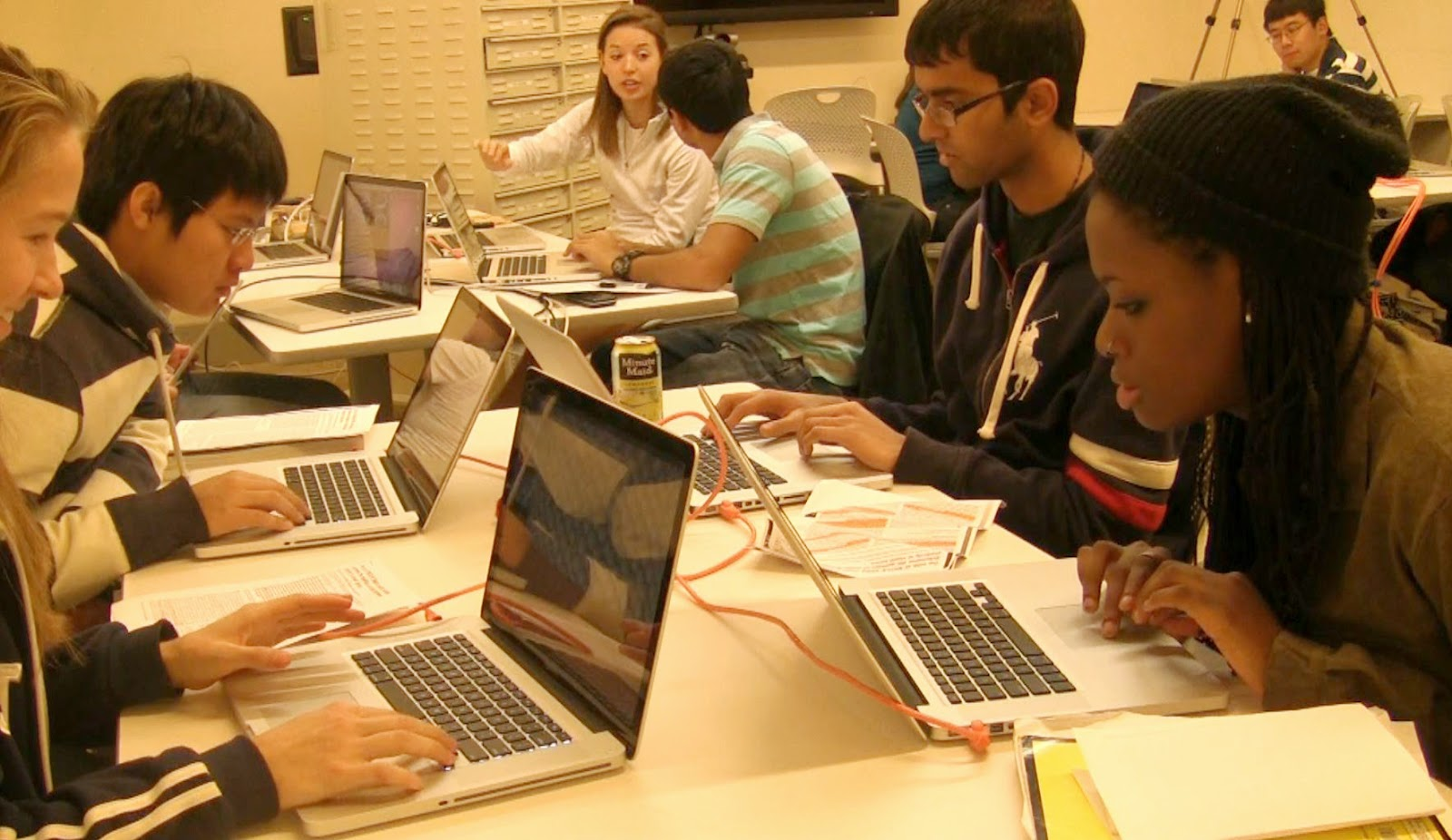 Students using a classroom set of laptops