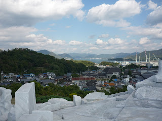 "View from ""The Heights of Eternal Hope for the Future"" over Setoda, the Seto sea, islands and mountins with marble in the foreground"