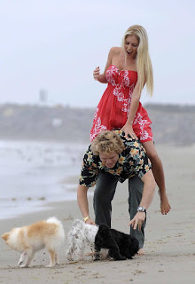Heidi Montag walking along the beach in Cali barefoot in a sundress