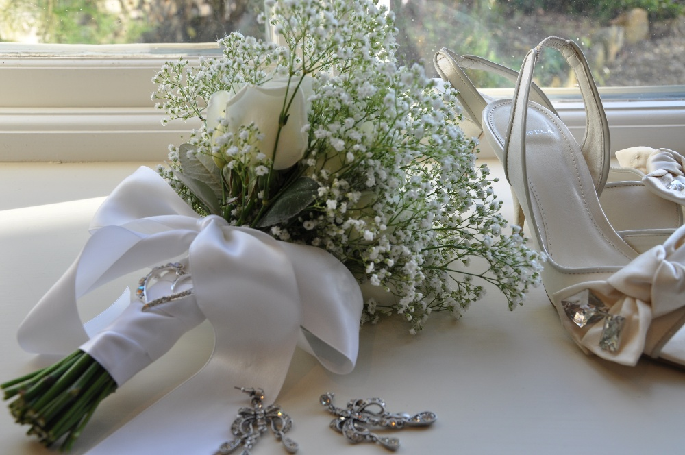 Helen jane floristry favourite flower for january gypsophila a simple bouquet of white gypsophila and white roses lends itself to some additional decorative detail such as this diamante brooch placed on the bouquet mightylinksfo