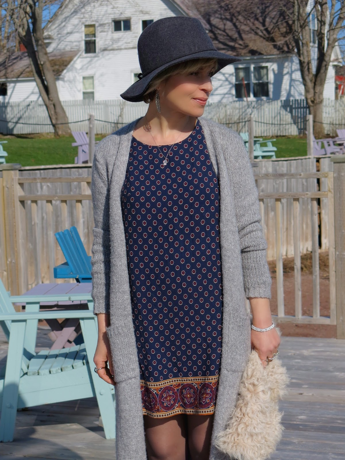 printed dress, long cardigan, and floppy hat