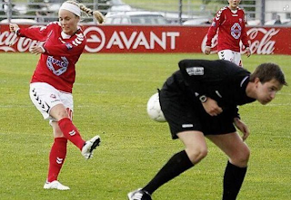 Funny football picture, female football player shoot the ball against referee