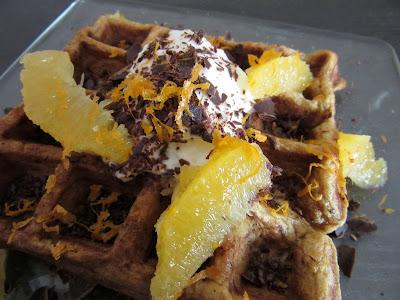 Pumpkin Spice Waffle topped with yogurt, orange segments + zest and shaved chocolate