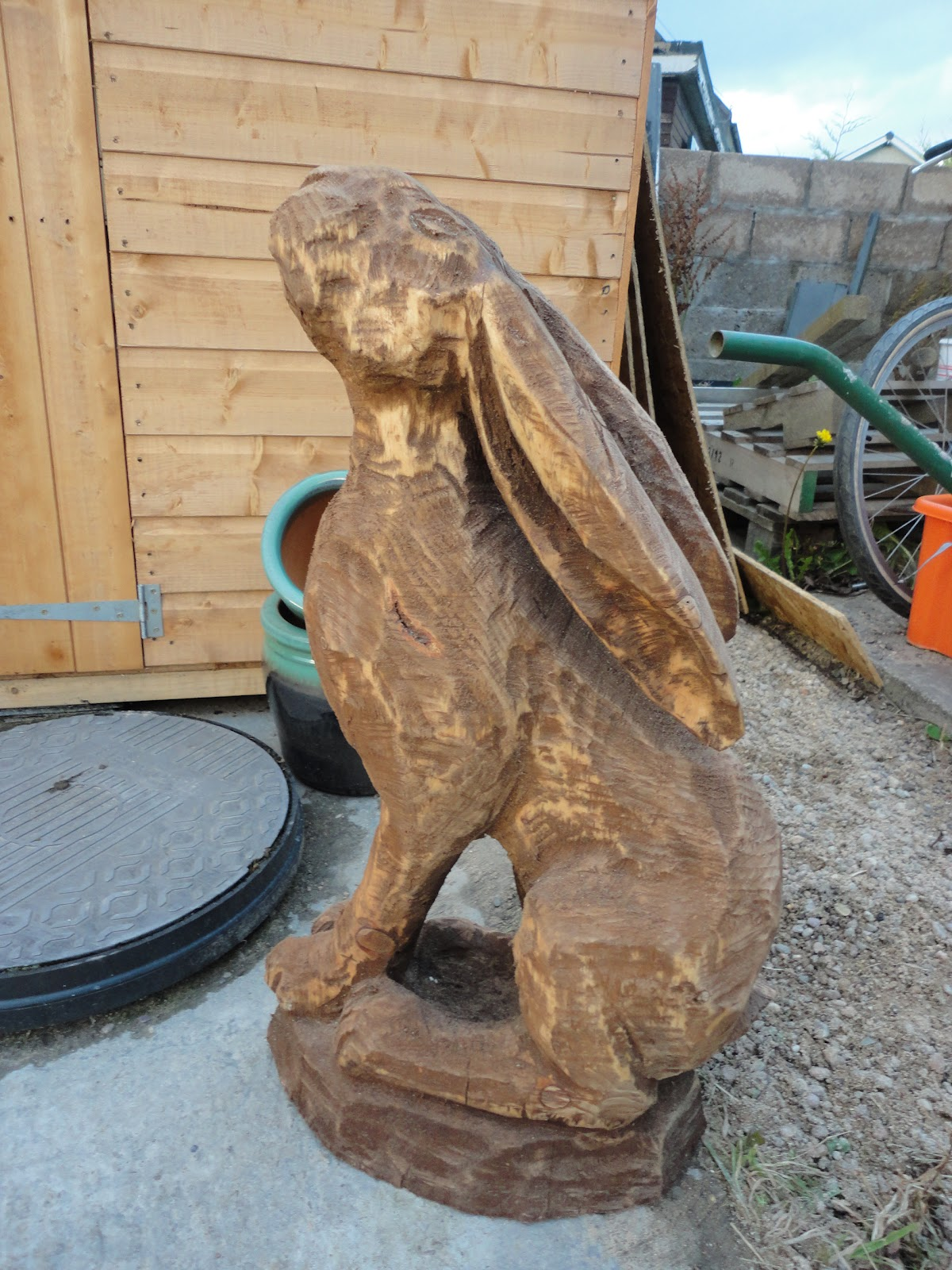 Lazy daisy glass open studios chainsaw carvings