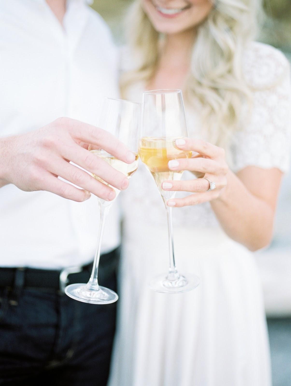 champagne glasses clink together