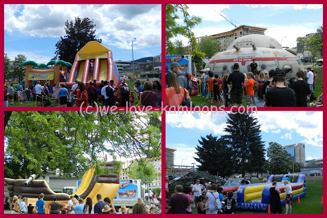 Several inflatable fun centers are set up for the kids to play in