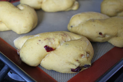 Shaped dough for pumpkin-cranberry-pecan twists
