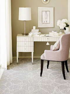 Soft gray and white swirl patterned area rug in small den