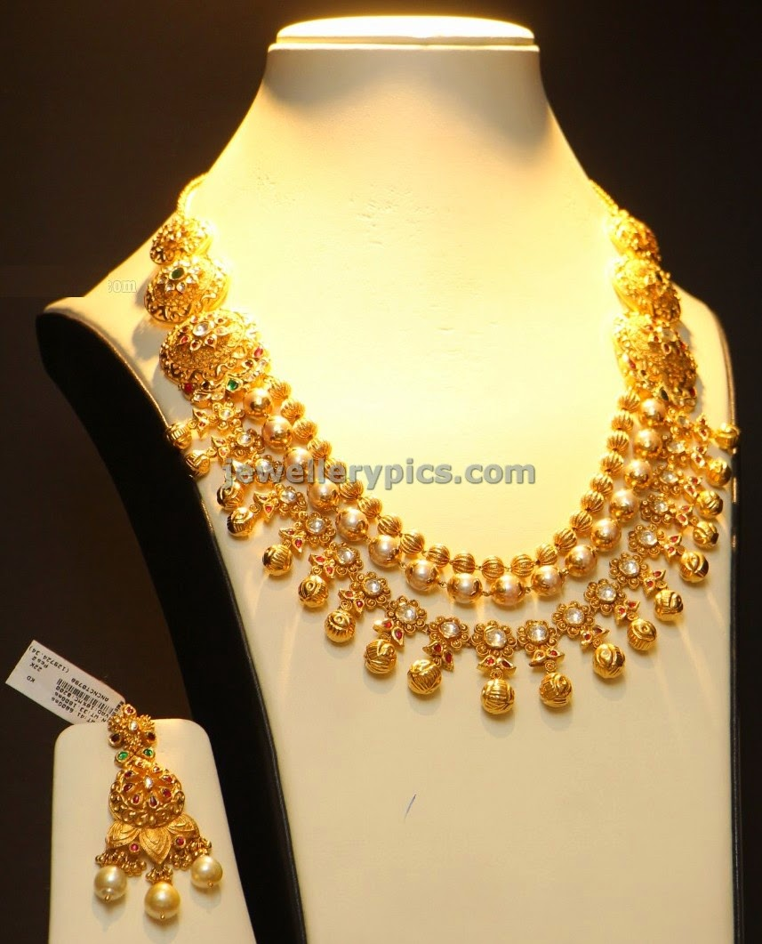 three step gold ball necklace
