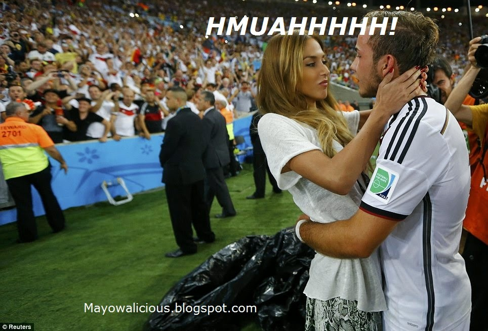 Germany's World Cup Hero, Mario Gotze Seals Up His Goal With A Kiss From His Sexy Girlfriend! Awww… Such A Painful Moment For Messi! He Mustn't See THIS Kiss Else…..