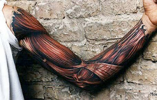 3d tattoo of the muscles and tendons covering the arm