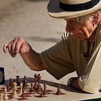Man playing chess (SOURCE: Wikimedia.org)
