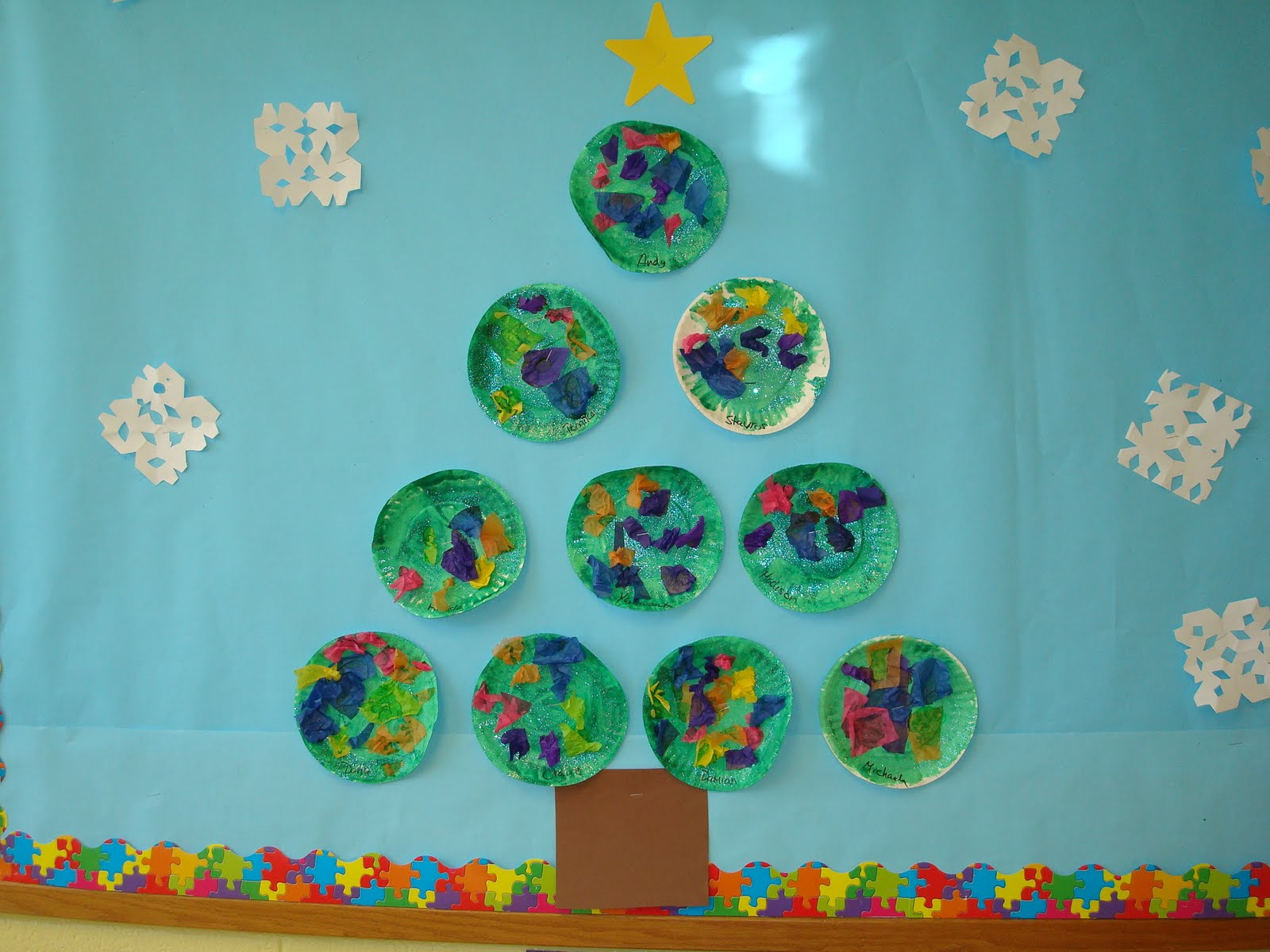 snowman and christmas bulletin board at trinity preschool